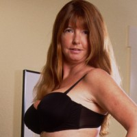 Helena  - Hi I'm Helena, shapely and highly - sexed mature lady, with long legs, auburn hair and green eyes. I am a size 12 with perky DD Tits and auburn bush;