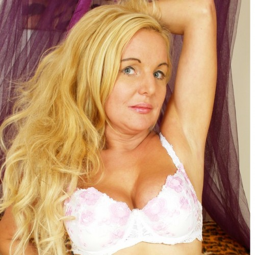 Julie - I am blonde, curvy, Mature Irish granny.  I have a really naughty side and love nothing more than dressing up in my sexy lingerie showing off my 38 DD tits